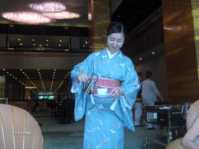 Picture of a waitress wearing a Kimono in our hotel in Osaka Japan